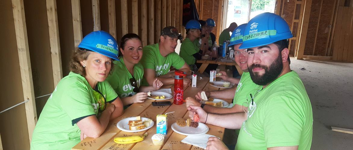 volunteers eating lunch at table