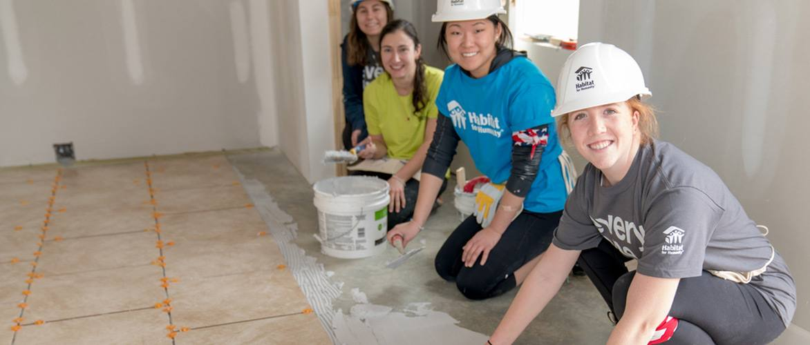 volunteers putting in flooring